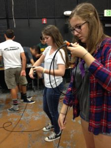 Students learn to wrap XLR audio cables correctly.